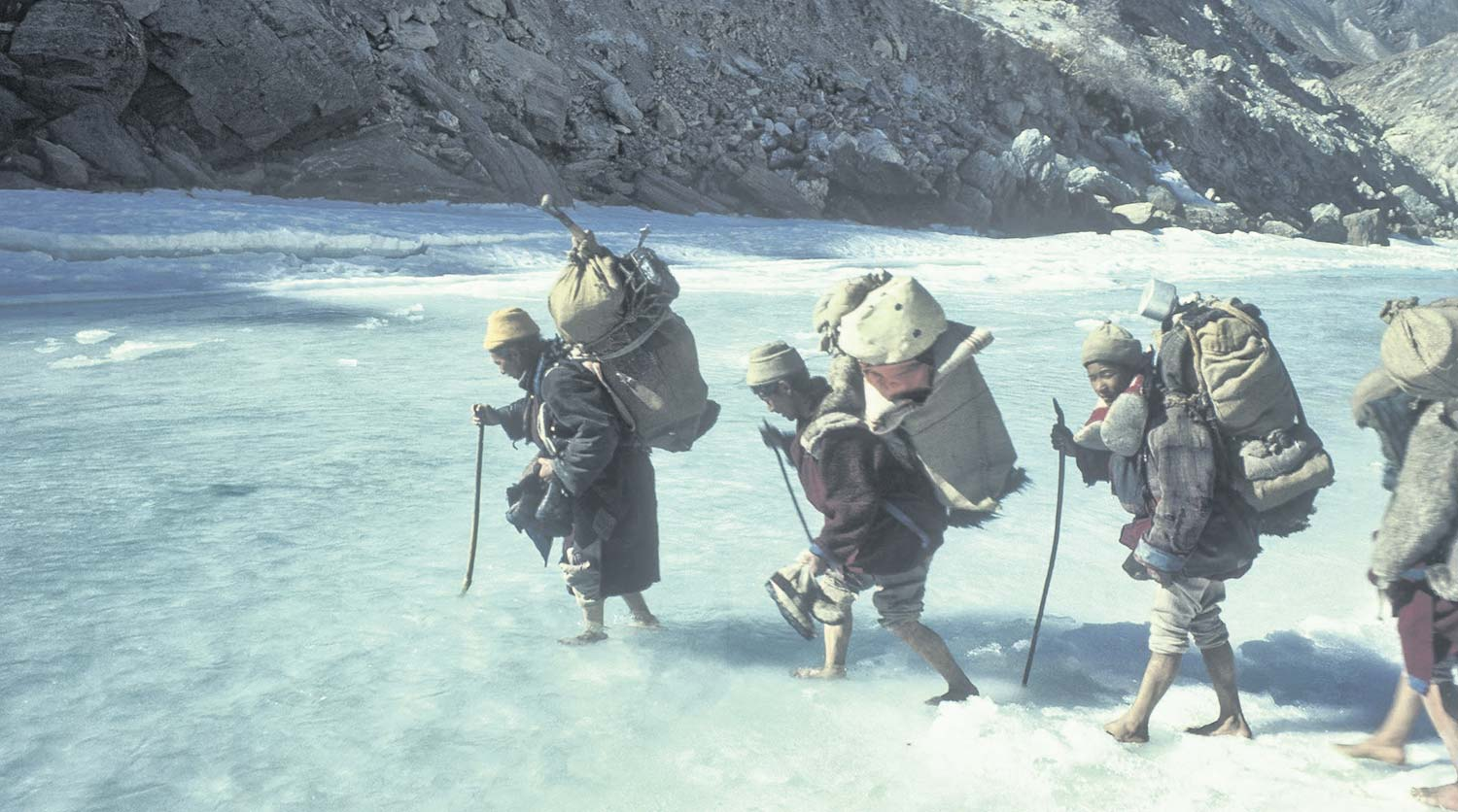 Dorje Tsering Leads Walkers Across The Icy River